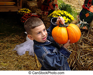 October Fun - Photo of Child Holding a Pumpkin.