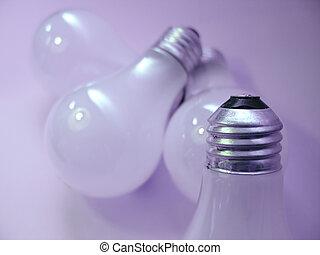 Bulbs - 4 white, matte light bulbs. Focus on tip of the...