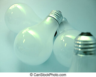 Bulbs 2 - 4 white, matte light bulbs. Focus on 3 bubls in...