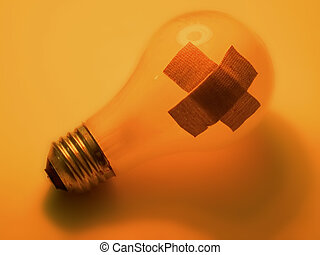 Broken bulb - A broken light bulb with 2 bandaids on it...