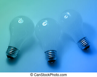 Bulbs 4 - 3 white, matte light bulbs on blue/green...