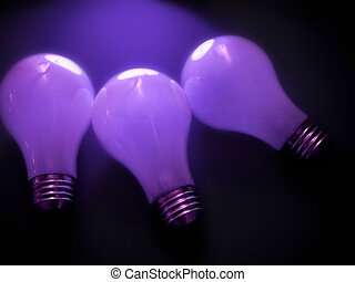 Bulbs 3 - 3 white, matte light bulbs in a dark environment....