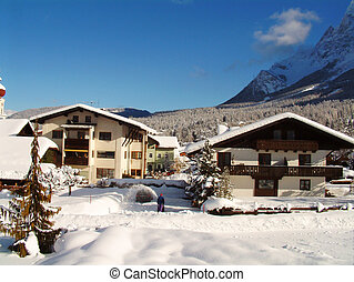 Alpine winter view - Austrian House in snow with person...