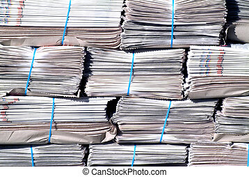 News - Bundles of newspapers piled in a stack