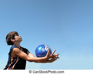 Soccer Ball Catch - Tween boy catches a soccer ball against...