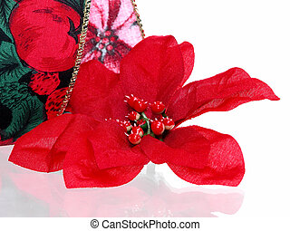 Christmas Flower - Artificial red poinsettia bloom against a...