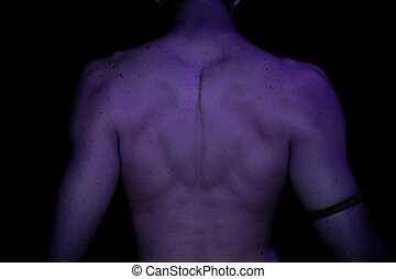 Study in Purple - Abstract view of young man's back in...