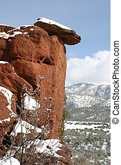 Red Rock Cliff - Snow covered red rock cliff overlooks snowy...