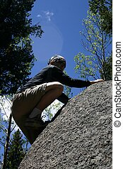 Bouldering - Teenager bouldering in the foothills around...