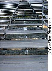 Bleachers - Empty bleachers at a high school stadium await...