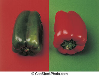 jing and jang - Two peppers Red one on green surface, green...