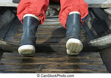 Rubber Boots - A pair of rubber boots in a boat.