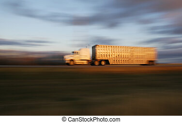 Cattle Truck - Panned cattle truck at sunset