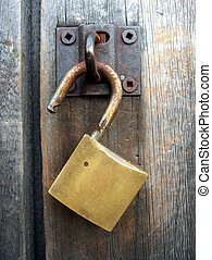 Padlock Detail - Detail of padlock on an old weathered shed...