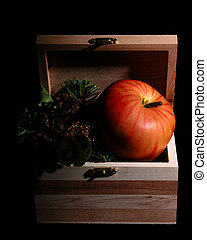 Apple in a Box - Apple in a small wooden box. Dramatic light...