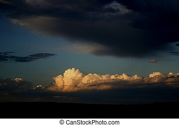 Storm Approaching - Building thunderhead is highlighted by...