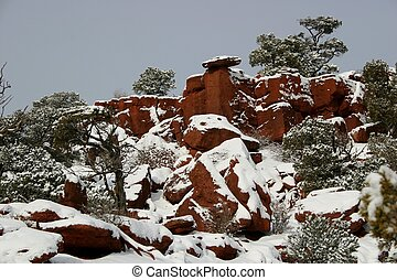 Red Canyon in Snow - Red Canyon rock formations blanketed by...