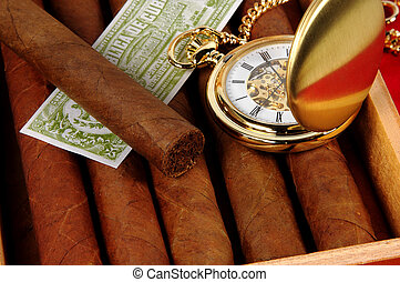 Cigars 3 - Photo of Cigars and a Watch