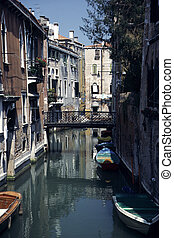 Venice - Small Canal in Downtown Venice with Boats anchored...