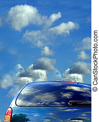 Blue sky and clouds reflected in the car