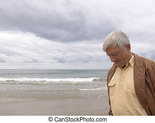 Pondering - Elderly man pondering by the ocean