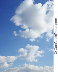Fluffy White Clouds - Fluffy white cumulus clouds in a blue...