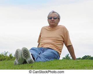 Contemplating - a man on the grass