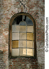 Abandoned Window - A window in an old abandoned brick...