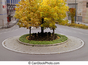 Traffic Circle - A traffic circle in autumn, in europe,...