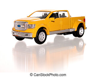 Toy Truck - Little yellow toy truck on white with...