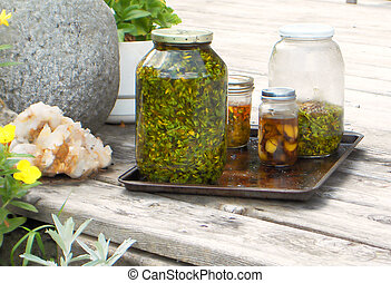 St Johns Wort - Bottles of St Johnswort and other herbs and...