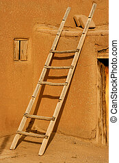 Ladder leaning on a pueblo house.