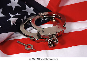 American Justice 2 - Photo of Handcuffs and American Flag