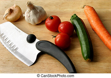 vegetables - different kind of vegetables and knife to cut...