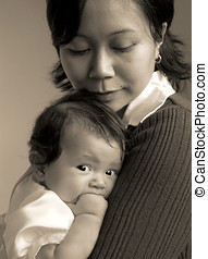 cuddle zone - newborn baby with mom asian oriental