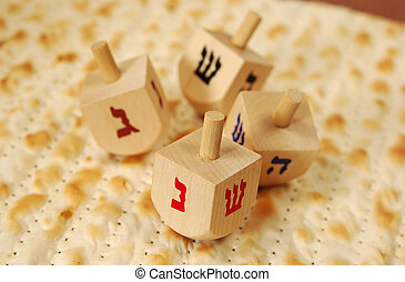 Matzoh and Dreidels - Photo of Matzoh and Dreidels