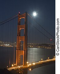 Golden Gate Tower - Golden Gate bridge at night, focused in...