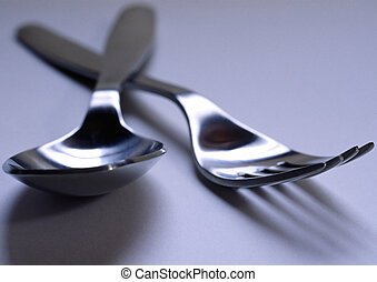 Silverware - A spoon and a fork.