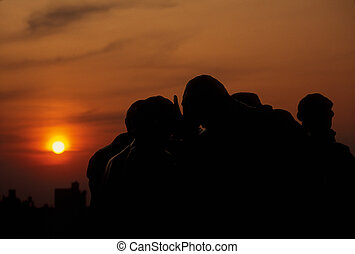 Statues in sunset - Silhoutte of statues against sunset in...