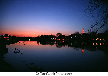 Sunset at Charles River in Boston with Harvard University in...