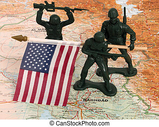 US in Iraq - Plastic green army men with a US flag on a map...