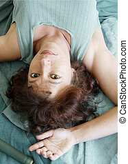 Beautiful woman lying upside down