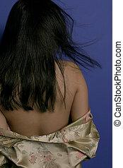 Back - Asain girls back toward camera wearing a silk robe.