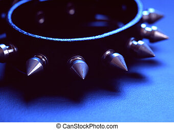Spike - A spiked collar in blueish light.