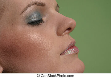 Face - Image of a womans face close up with make up on.