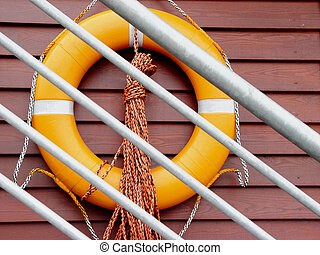 lifebelt in a harbour behind a banister