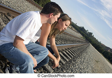 Couple on Tracks - A young couple sitting on the train...