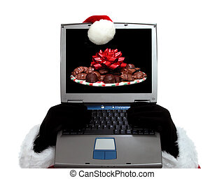 Santa's Wish - Santa behind a laptop computer with an image...
