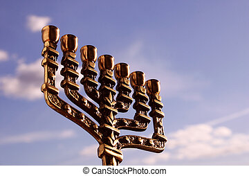 Menorah close-up against the sky