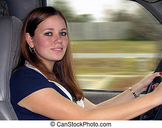 teen driving - Young teen woman driving a car with hands on...